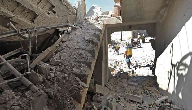 The destruction caused by reported govenrment forces' bombings in the town of Al Habit on the southe