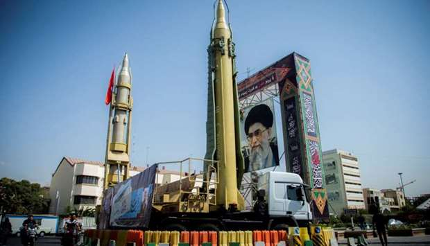 A display featuring missiles and a portrait of Iran's Supreme Leader Ayatollah Ali Khamenei is seen