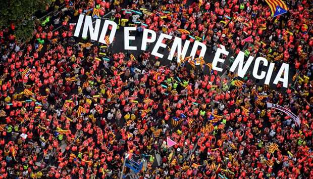 """People hold up the letters spelling out """"Independencia"""" (Independence) during a rally on Catalonia's"""