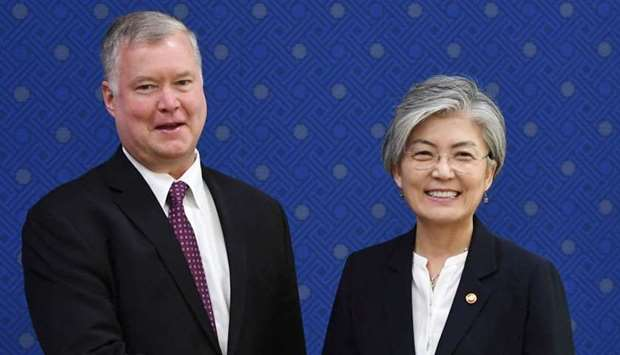 South Korean Foreign Minister Kang Kyung-wha shakes hands with U.S. special representative for North