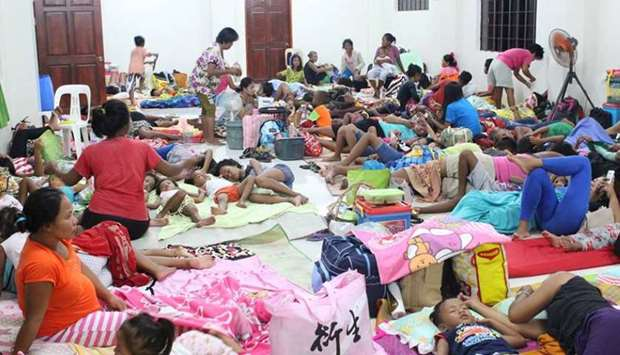 People are seen inside an evacuation centre in preparation for Typhoon Mangkhut in Cagayan, Philippi