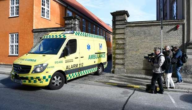 An Ambulance leaves the court building on the day of the verdict for the pending appeal in the case