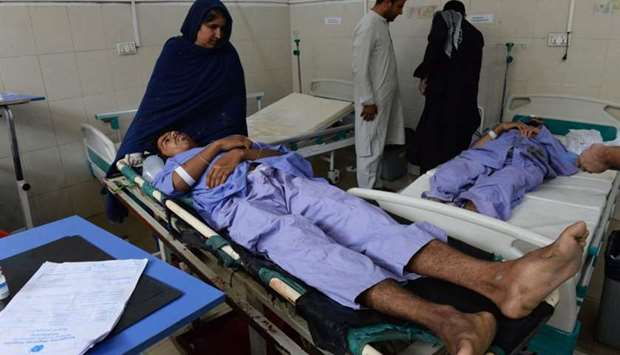 Afghan victims receive treatment at a hospital the day after a suicide attack targeting protesters i