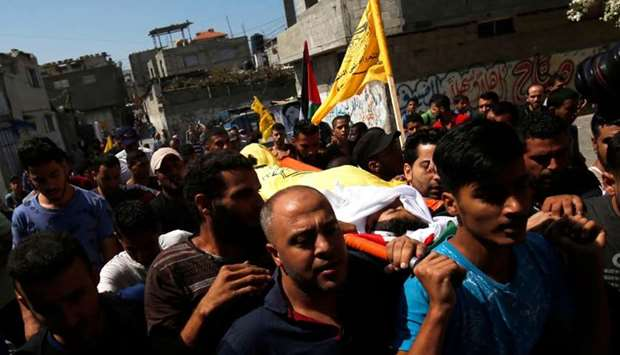 Palestinian mourners carry the body of 12-year-old Palestinian boy Shadi Abdel Aal
