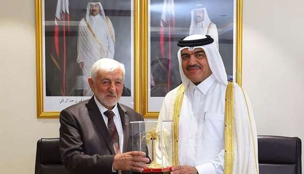 HE Mohammed bin Abdullah al-Rumaihi and Dr Sufian Sultan after signing an agreement.