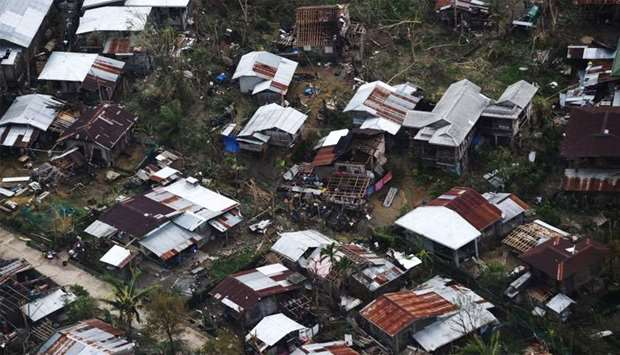 Aerial shot of houses destroyed at the height of Typhoon Mangkhut at a village in Gattaran town, in