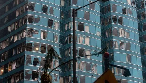 A general view shows windows of a commercial building smashed during Super Typhoon Mangkhut in Hong