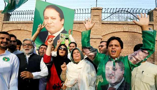 Supporters of former Prime Minister Nawaz Sharif react as they celebrate following the court's decis