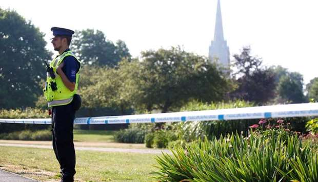 A police officer guards a cordoned off area of Queen Elizabeth Gardens, after it was confirmed that