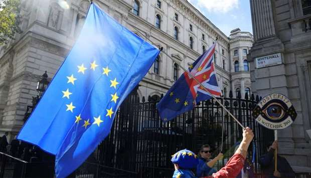 An anti-Brexit demonstrator holds a flag outside Downing Street in London, Britain