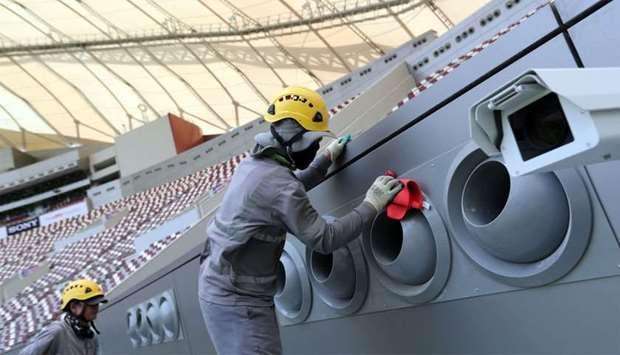 Shows labourers working at a Stadium ahead of the Qatar 2022 FIFA World Cup