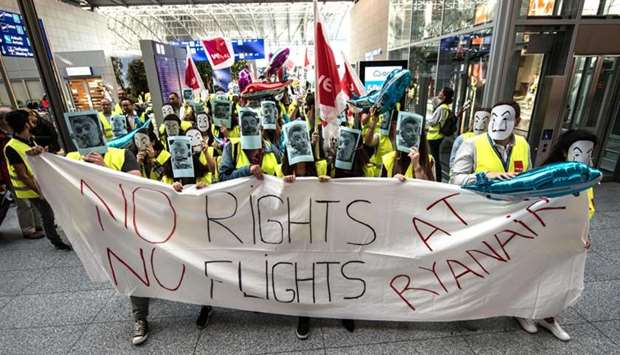 "Employees of Irish airline Ryanair hold a banner reading ""No Rights-No Flights at Ryanair"""