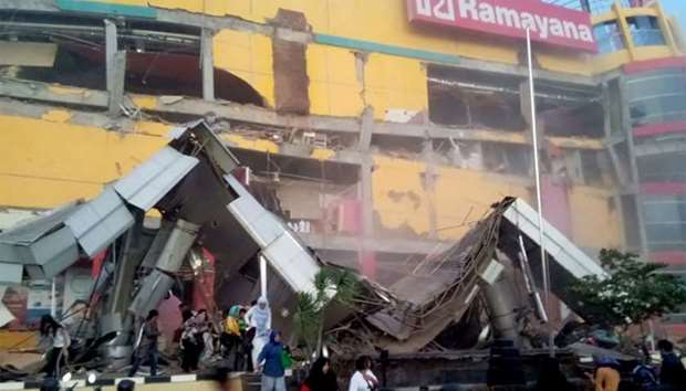 A shopping center heavily damaged following an earthquake in Palu, Central Sulawesi