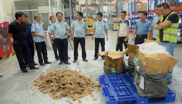 Vietnamese customs officials checking pangolin scales seized in Hanoi.