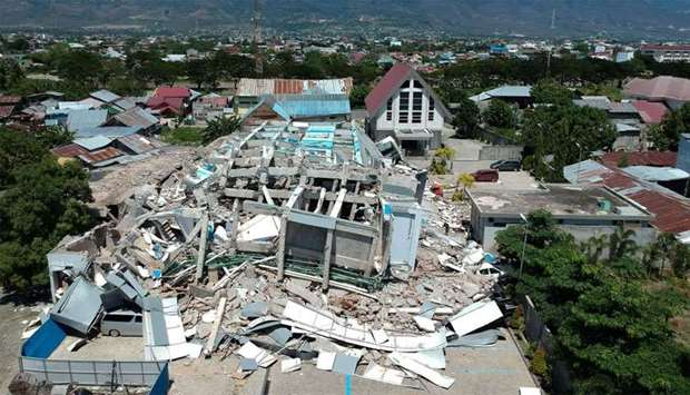 This aerial picture shows the remains of a ten-storey hotel in Palu in Indonesia's Central Sulawesi