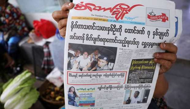 A Myanmar newspaper displays the story about the sentences received by Reuters journalists Wa Lone a