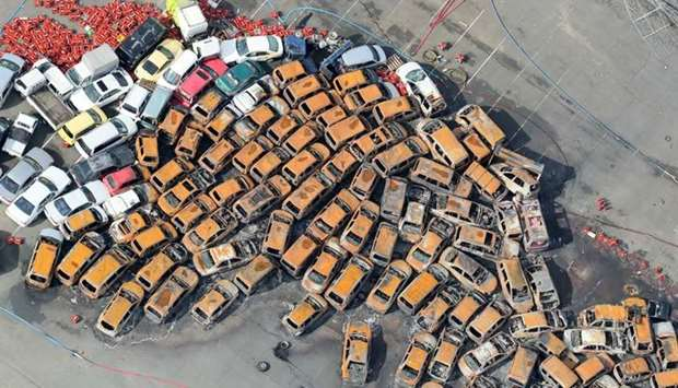 An aerial view from a Jiji Press helicopter shows passenger vehicles which were burnt after a storm