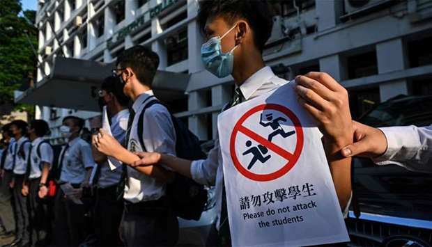 Students take part in a joint 'school human chain rally' in Hong Kong