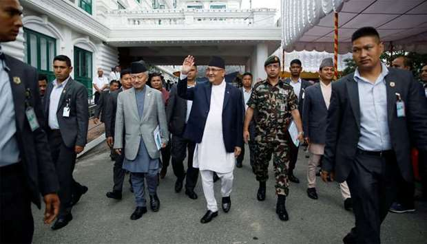 Nepal's Prime Minister Khadga Prasad Sharma Oli, also known as K.P. Oli, smiles as he walks out afte