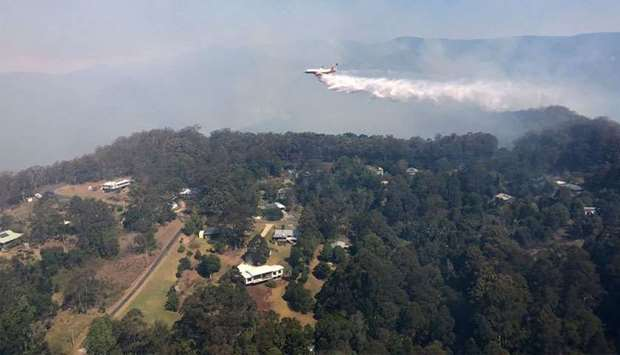 Queensland Fire and Emergency Services shows a firefighting 737 jet water bombing a fire at Binna Bu