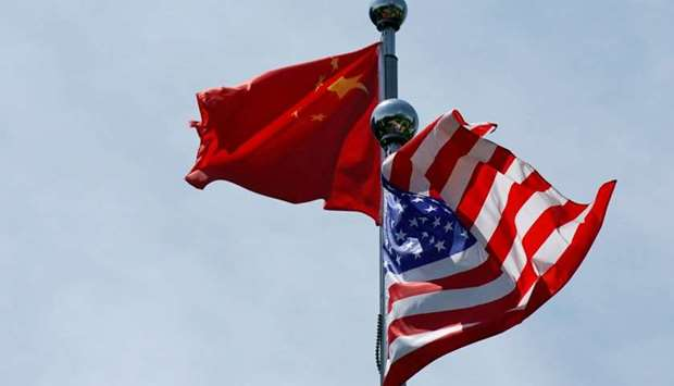 Chinese and US flags flutter near The Bund, before US trade delegation meet their Chinese counterpar
