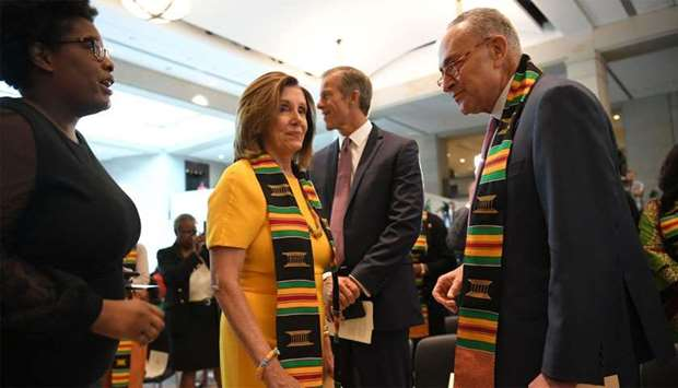US House Speaker Nancy Pelosi (L), Democrat of California, and US Senate Minority Leader Chuck Schum