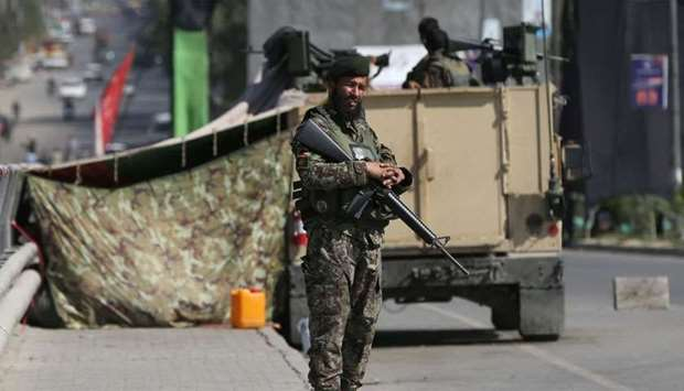 An Afghan National Army (ANA) soldier stands guard at a check point in Kabul