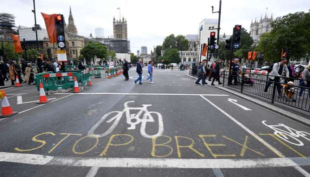 "A writing on the roadside that reads ""Stop Brexit"" is seen near the Houses of Parliament in London,"