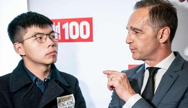 Hong Kong pro-democracy activist Joshua Wong (L) talks with German Foreign Minister Heiko Maas as th