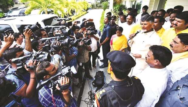 Former Andhra Pradesh chief minister N Chandrababu Naidu talks to press after he was placed under ho