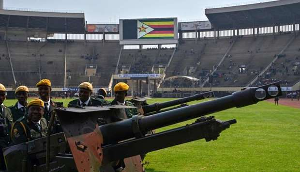 Zimbabwe soldiers prepare ceremonial canons to be used in rendering a gun salute, at the National Sp