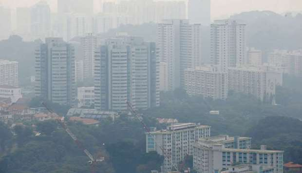 Public housing apartment blocks are shrouded by haze yesterday in Singapore