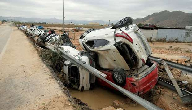 New cars are seen piled after a flood caused by torrential rains in Orihuela, Spain