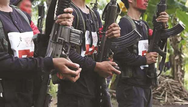 New People's Army fighters are seen during the Communist Party of the Philippines' 50th anniversary.