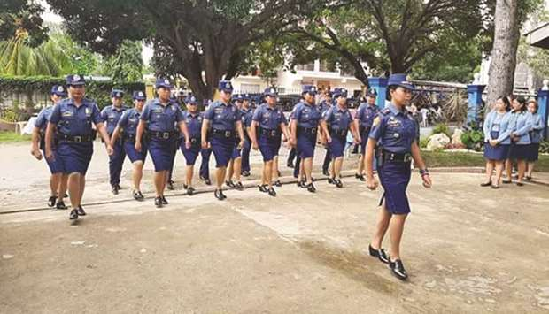 Officers and members of Maria Municipal Police Station march during the launch of the all-women poli