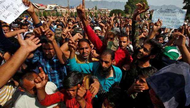 Kashmiris shout slogans at a protest site after Friday prayers during restrictions in Srinagar.