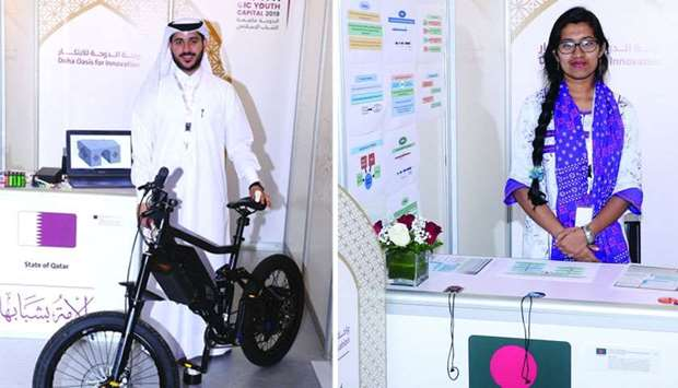 Saleh Mohamed al-Abdullah from Qatar with the advanced bike he developed and Shomotta Sayed from Ban