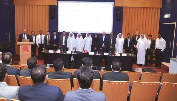 Ooredoo and Gulf Exchange officials during the partnership announcement.