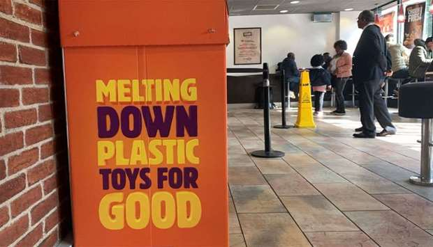 A plastic toy recycling box is seen inside a Burger King restaurant in Manchester