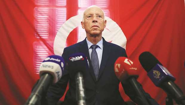 Presidential candidate Kais Saied speaks as he attends a news conference after the announcement of t