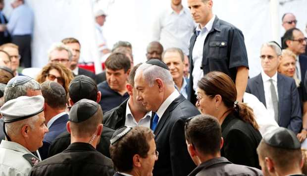 Israeli Prime Minister Benjamin Netanyahu arrives to a memorial ceremony for late Israeli President