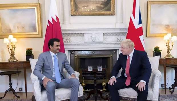 His Highness the Amir Sheikh Tamim bin Hamad al-Thani and British Prime Minister Boris Johnson holdi