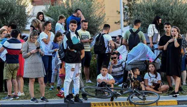 Residents gather outdoors in Tirana after two earthquakes above 5.0 magnitude struck the coastline A