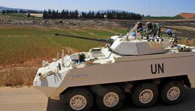 Irish soldiers of the United Nations Interim Forces in Lebanon (UNIFIL) patrol a road in the souther