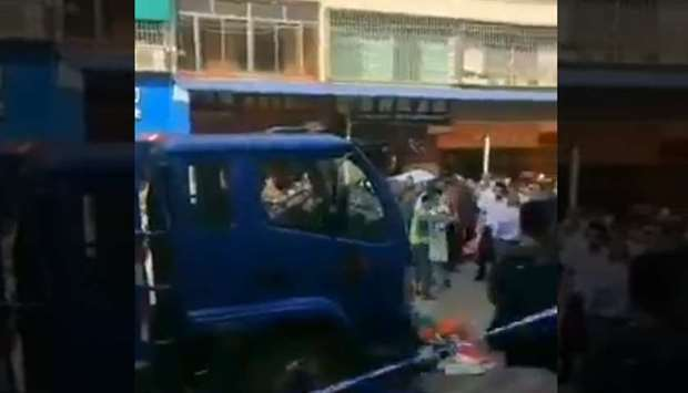China- A truck ploughed into a crowd of people at a street market