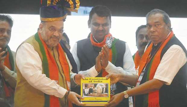 Home Minister Amit Shah attends a meeting of BJP workers in Mumbai yesterday.
