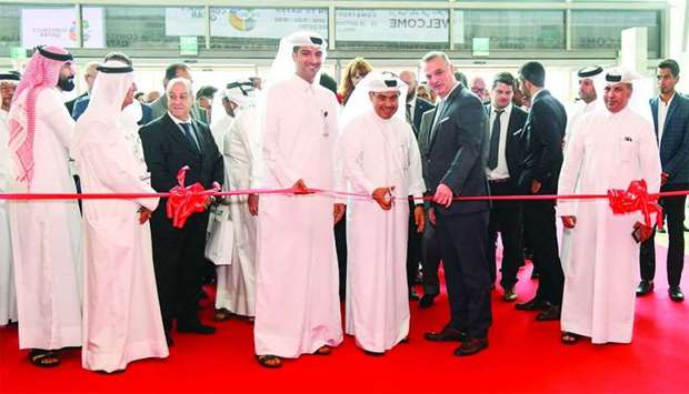 HE the Minister of Commerce and Industry Ali bin Ahmed al-Kuwari leading the ribbon-cutting ceremony