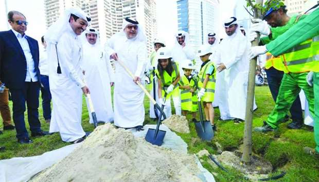 Ashghal president Dr Saad bin Ahmed al-Mohannadi and other officials take part in a tree-planting ex