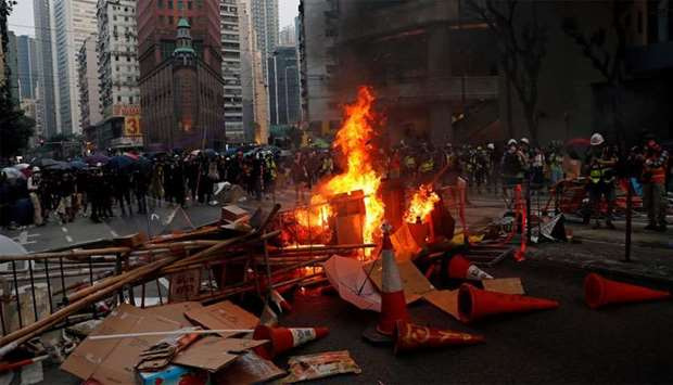 Anti-government protesters set barricades on fire after a clash with riot police in Hong Kong