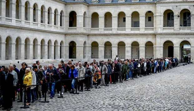People queue to say a final farewell to former French President Jacques Chirac as the coffin lie in